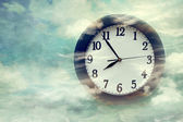 Wall clock on surreal background — Stock Photo