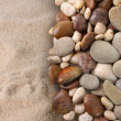 Colorful river stones on sand — Stock Photo #5483384