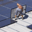 Workers set photovoltaic panels — Stock Photo #42616523