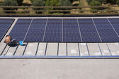 Workers set photovoltaic panels — Stock Photo