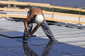 Workers set photovoltaic panels — Стоковое фото