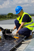Engineer testing solar panels — Stock Photo