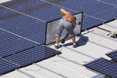 Workers set photovoltaic panels — Stockfoto