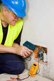 Senior electrician repairing the electrical system — Stock Photo