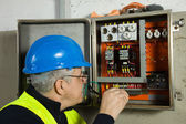 Senior electrician check the electrical panel — Stock Photo