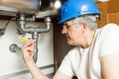 Senior Plumber repairing water boiler — Stock Photo