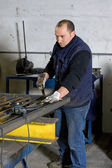 Man working with steel — Stock Photo
