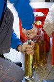 Craftsman opening cork of bottles — Foto de Stock