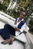African student with newspaper — Stock Photo