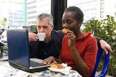 Man and woman having breakfast — Stock Photo