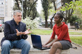 Woman and man talking in park — Stock Photo