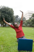 Woman in park with laptop — Stock Photo