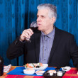 Man eating sushi and drinking red wine — Stock Photo #48458663