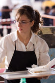 Waitress carries a tray of food — Stock Photo