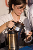 Waitress pours coffee — Stock Photo