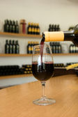 Wine is poured into a glass — Stock Photo