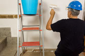 House painter painting wall — Foto de Stock