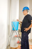 House painter painting wall — Stock Photo