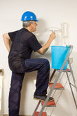 House painter painting wall — Стоковое фото