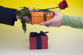 Man gives woman rose and gift — Stock Photo