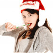 Eating a candy cane. — Stock Photo