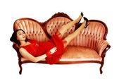Girl lying on sofa. — Stock Photo