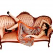 Pretty woman on sofa. — Stock Photo