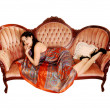 Stock Photo: Pretty woman on sofa.