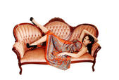 Pretty woman on sofa. — Stock Photo