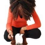 Girl crouching on scale. — Stock Photo #21260845