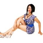 Pretty girl sitting on floor. — Stock Photo