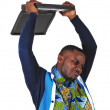 Black man throwing his laptop. — Stock Photo #38008023