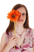 Girl holding flower. — Stock Photo