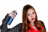 Girl putting hairspray on. — Stock Photo