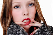 Girl with finger on lips. — Stock Photo