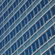 Blue glass high rise building skyscrapers — Stock Photo #19585901