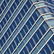 Blue glass high rise building skyscrapers — Stock Photo #19585911