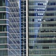 Blue glass high rise building skyscrapers - Stock Photo