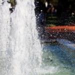 Splashing water of fountain in sunlight — Stock Photo #12736040