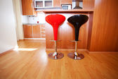 Kitchen interior with bar chairs in the apartment — Stock Photo