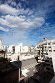 View of the city and the blue sky with clouds — Stock Photo