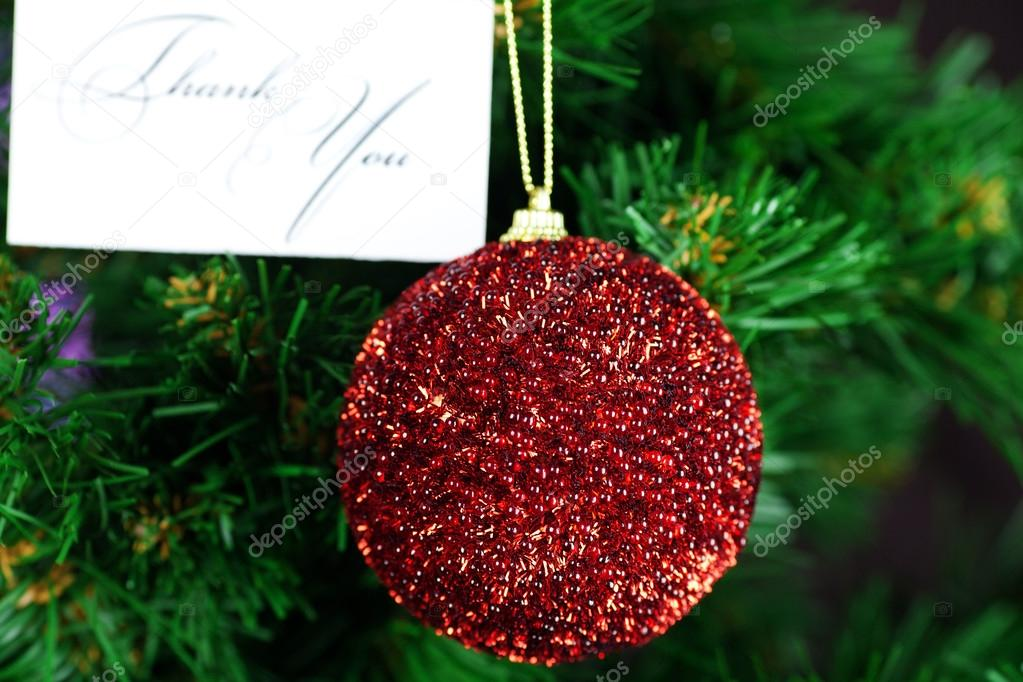 Christmas Toy and card thank you on the Christmas tree — Stock Photo #13693124