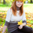 Portrait of a beautiful young redhead teenager woman in a wreath — Stock Photo