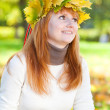 Portrait of a beautiful young redhead teenager woman in a wreath — Stock fotografie