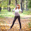 Young redhead teenager woman in the forest - Stock Photo