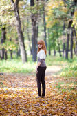 Young redhead teenager woman in the forest — Stock Photo