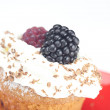 Muffin with whipped cream,mint, raspberries, blackberries and nu — Stock Photo