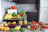 Abundance of fruits and vegetables in the kitchen — Stock Photo