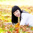 Portrait of a beautiful young woman in autumn forest — Stock Photo