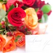 Stock Photo: Bouquet of colorful roses and card with words thank you